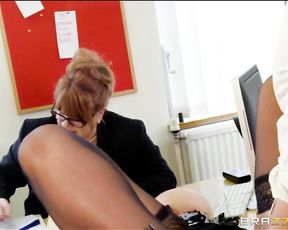 The guy licking her pussy under the desk is there to test her concentration