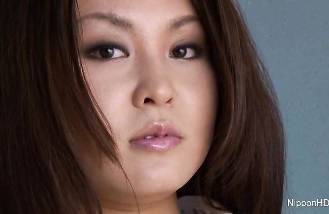 Long-haired Asian stunner spreads legs to tease her hairy cunt in the shower