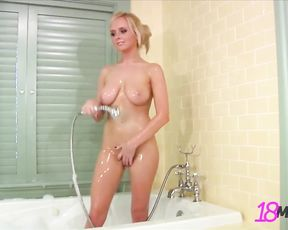 Busty woman with a flawless body takes a shower stroking herself nicely
