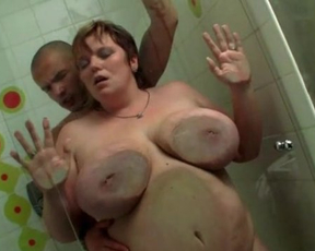 Big fat whore gets scored by a skinny dude and banged in the shower