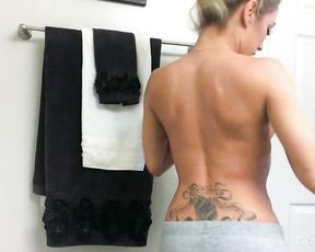 Glamour wet bombshell with a tattooed back relaxes alone in the shower