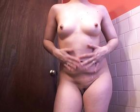 Girl is secretly filmed in the shower as she touches her nice body