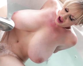 Mature blonde slut with huge tits masturbates in the shower until she cums