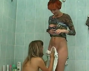 You will cum in minutes watching these two lesbians sharing in dildo in the shower