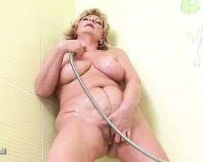 Mature bitch screams while masturbating in the shower with a huge dildo