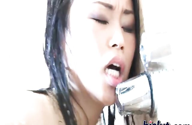 Two asian pussies make eachother cum in the shower in this lesbian scene