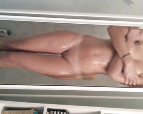 Slender bitch spreads her ass and pussy knowing she is filmed in the shower