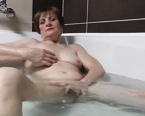 GILF masturbates until she cums in the shower hardcore and loves it
