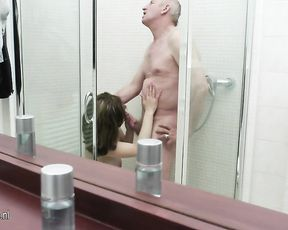 Old dude gets a blowjob from a slut in the shower then fucks her