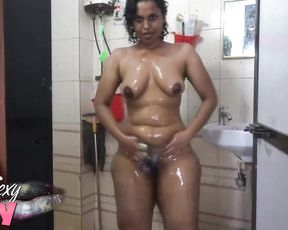 Ebony rubs her pussy under shower in solo masturbation scenes