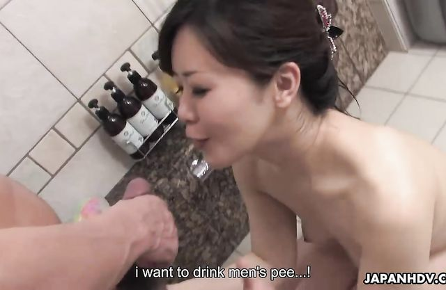 Naked Japanese wife sucks cock in the shoer then swallows
