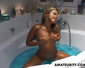 Tanned blonde shows passionate blowjob in the shower while on cam