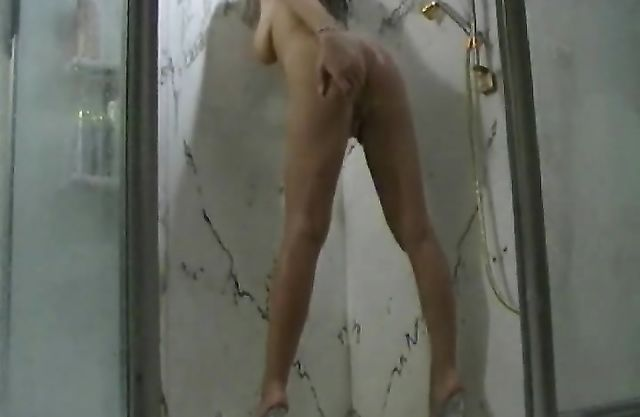 Smoking hot leggy angel in high heels plays with her wet cunt in the shower