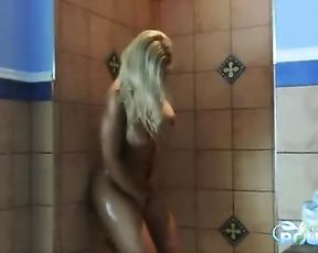 Stunning nude blonde plays with her big boobs in the warm shower