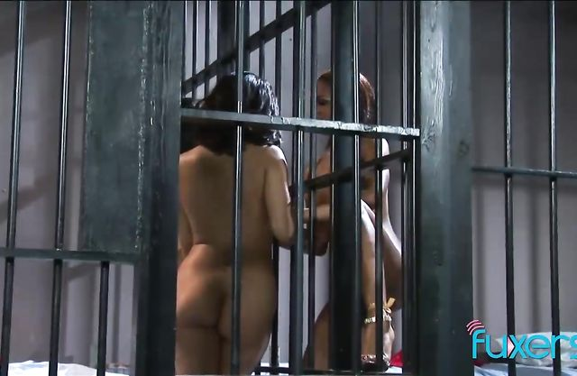 Latina prisoners team up to penetrate naked black newbie with toys