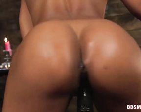 Blindfolded submissive with naked body sucks mistress' black strapon