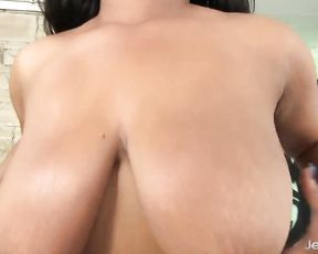 Natural-tittied black chick tempts viewers with her fascinating naked body