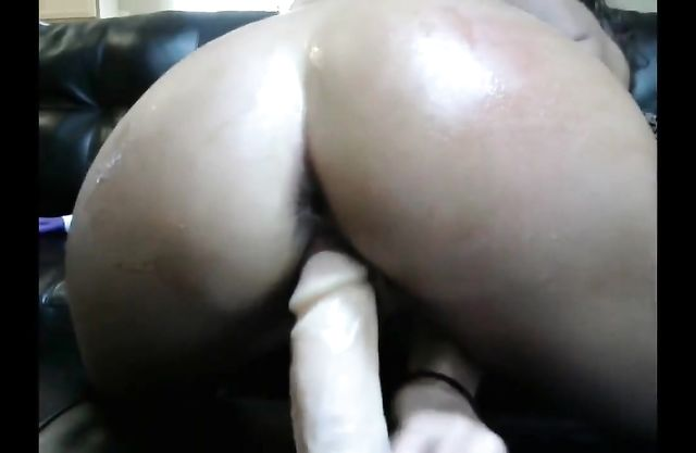 Provoking black young woman penetrates her own naked hole with sex toys