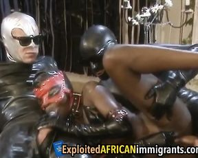 Naked Ebony slave takes part in nasty threesome with strange partners