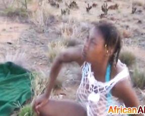 Black girl with dreadlocks shows cocksucking skills at naked safari
