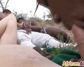 Black girl with dreadlocks shows cocksucking skills at naked safari