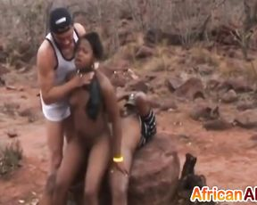 Ebony chick practices cock riding outdoors after naked spanking