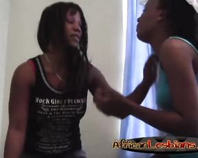 Ebony skinny takes clothes off and lies naked on back enjoying cunnilingus