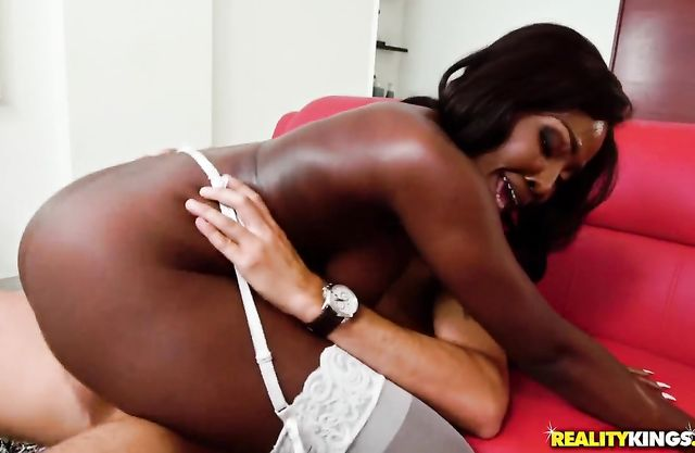 Ebony maid with big naked breasts likes to ride a hard white dick