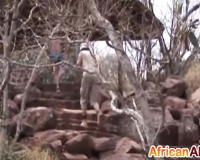 Submissive Ebony gal jumps on naked man's dick somewhere in desert