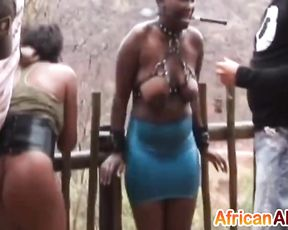 Two naked Ebony slaves dominated in fresh air by impudent masters