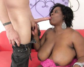 Man impales black BBW partner on couch and cums on her naked melons