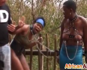 Perverted guys pinch naked tits of two amateur Ebony sluts outdoors