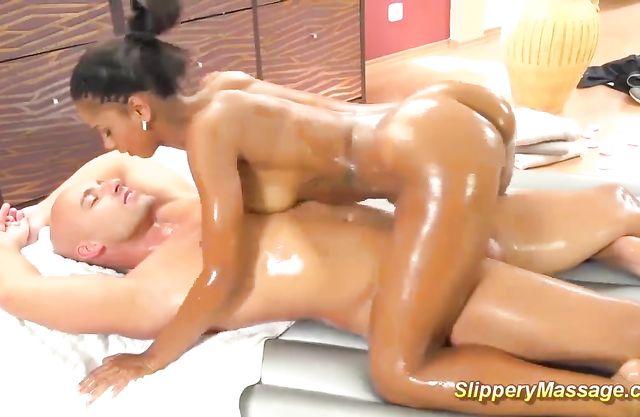 Ebony masseuse gets naked, oils herself and gives orgasmic massage