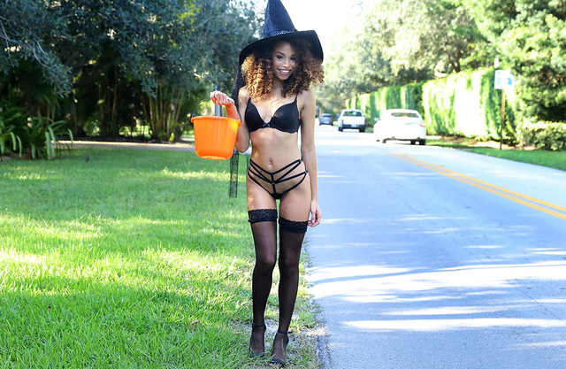Sexy black witch gets a big cock while Trick or Treating