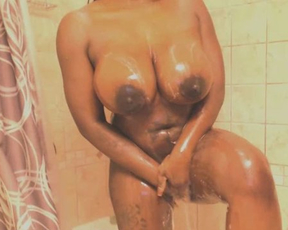 Black webcam model sucks dildo and shows huge naked tits in shower room