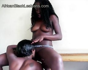 Tempting Ebony girl with long legs shares stripped naked pussy with BFF