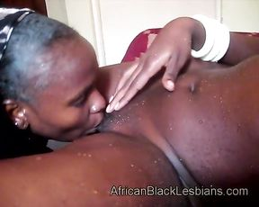Naked Ebony babe fingers lover's pussy in shower and takes her to bed