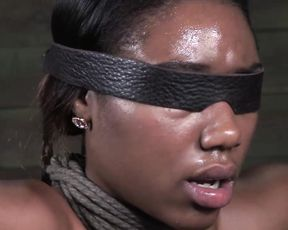 Ebony chained up female is the slave of naked sexual ambitions of BDSM lover