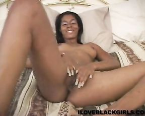 Solo masturbation scene with an ebony bitch with a nice body and her dildo