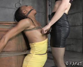 Bound ebony chick gets teased by a crazy lesbian slut in the interracial action