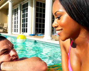 Fascinating ebony bombshell gives her oiled up pussy to a guy on the poolside