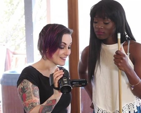 Active ebony girl involves her sexy tattooed girlfriend into a lesbian action
