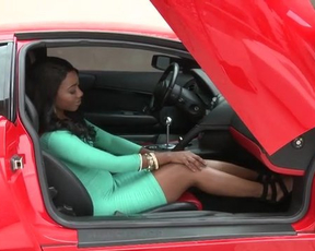 Sitting in car motivates Ebony model to tease naked curves on camera