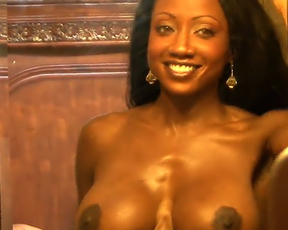 Naked Ebony MILF with huge tits comes into the bedroom and rides dick