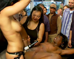 Naked girl penetrates black slave with strapon while perverts watch