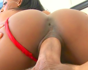 Young woman with Ebony skin tone leaves red panties on during naked coition