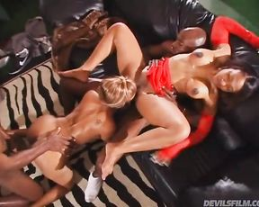 Excited Ebony couples enjoy naked anal foursome on the leather sofa
