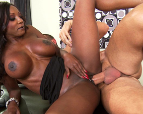 Naked guy and busty black MILF climb on table to enjoy spoons position