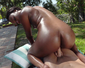 Ebony gal with perfect naked booty jumps on BF's dick in fresh air