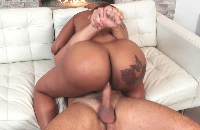 Excited man stretches Ebony sitter with naked curves all over sofa
